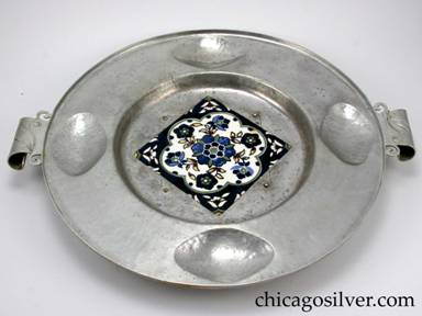 "Cellini tray, round, aluminum, with 5-3/4"" square ceramic tile inset at center.  Unusual scroll handles."