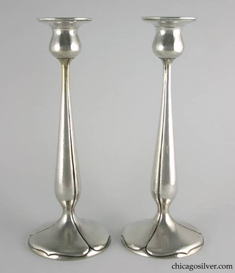 "Kalo candlesticks, tall, pair (2), hammered surfaces with pedestal base and tulip form with fluted sides and spade shaped designs on base.  11-15/16"" H and 4-5/8"" W across base and 2-3/4"" W across top.  Marked:  STERLING / HAND WROUGHT / AT / THE KALO SHOP / S402"
