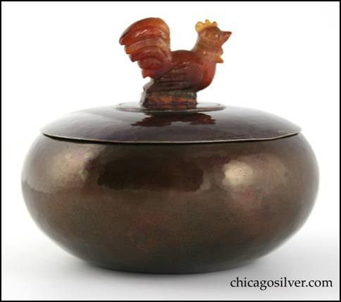 Rebecca Cauman bowl, round, copper, with removable silver lid, red-orange enameled interior and carved agate rooster finial inside small ring on lid.