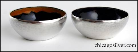 Rebecca Cauman salts, pair (2), enameled, with flat bottom and flaring sides that taper in slightly at the top, and nice hammering.  Interiors have dark rich blue enamel covering most of the surface, with a different color around the top inside edge (one is purple, the other yellow).  Heavy.