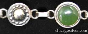Detail of Laurence Foss bracelet with cabochon chrysoprase stones on stepped small round silver frames