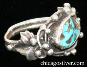 Ring, with freeform bezel-set turquoise stone surrounded by silver beads and curving wires.  On each side is an applied leaf with silver beads.