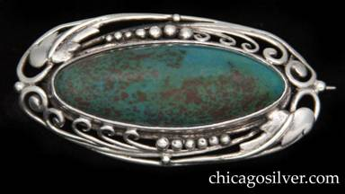 Frank Gardner Hale brooch / pin, oval frame in sterling silver with pattern of leaves, vines, beads and curving wirework top and bottom centering an oval cabochon bezel-set dark blue-green mottled turquoise stone