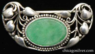 Frank Gardner Hale brooch, with floral pattern of vines and heart-shaped leaves on upturned kidney-shaped frame centering bezel-set oval green chalcedony stone ringed with a circle of very small silver beads