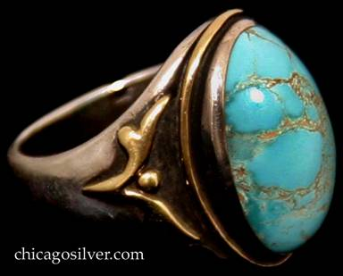 Frank Gardner Hale ring, size 6, handwrought in sterling silver with 14K gold applied accents and large central turquoise with gold matrix cabochon.  Heavy shank with simple stylized leaf and bead design on oxidized surface.