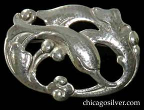 Randahl brooch, oval, with swirling design of leaping dolphin surrounded by waves and beads, on cutout frame.