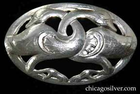Randahl brooch, oval, with chased and cutout form of two geese or swans facing each other with intertwined necks, on oval frame.