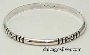 Kalo bracelet, bangle with four repeated design elements of three chased vertical lines forming two bars and surrounding a chased X