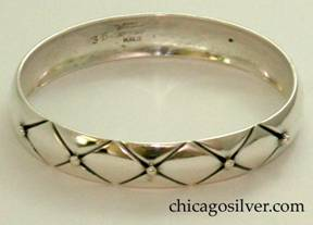 Kalo bracelet, bangle, wide, convex surface with long chased diagonal grooves forming pattern of four diamonds on each side and a silver beads at the side point of each diamond (ten beads total)