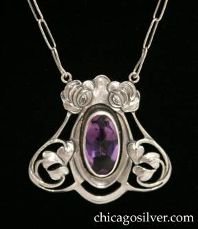 Kalo pendant on chain, handwrought in sterling silver with large cabochon amethyst with faceted back.  Silver frame with pierced open work, and stylized roses and leaves.