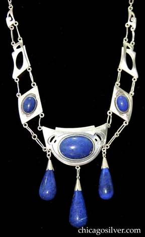 Kalo multipart necklace on paperclip chain, with cutouts, chased design, bezel-set lapis stones, and large teardrop-shaped lapis drops