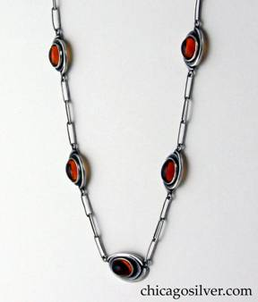 Kalo necklace on paperclip chain with seven amber plaques.