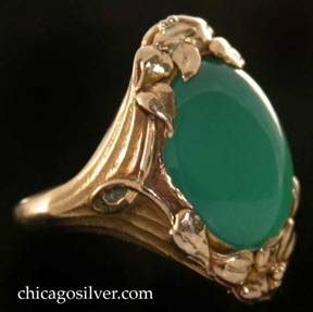 Kalo ring, gold, with large green oval cabochon chrysoprase bezel-set stone, and leaf and berry ornament at top and bottom