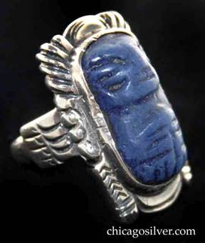 Kalo ring, Indian-motif, large and rectangular, with bezel-set dark blue carved stone inside heavy frame
