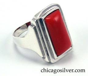 Kalo ring, handwrought in sterling silver with red coral cabochon.  Shank with stepped sides and central red coral cabochon.  Beautiful Deco design.
