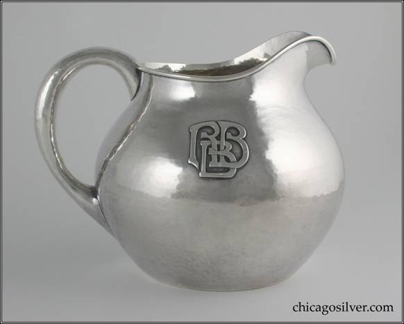 "Kalo pitcher, water, squat form, with looping hollow handle, arching spout, bulbous body, small opening with applied wire to rim, applied RBB mono on side.  Nice hammering.  6-1/2"" H and 8-3/8"" W.  STERLING / HAND WROUGHT / AT / THE KALO SHOPS / CHICAGO / AND / NEW YORK 12"