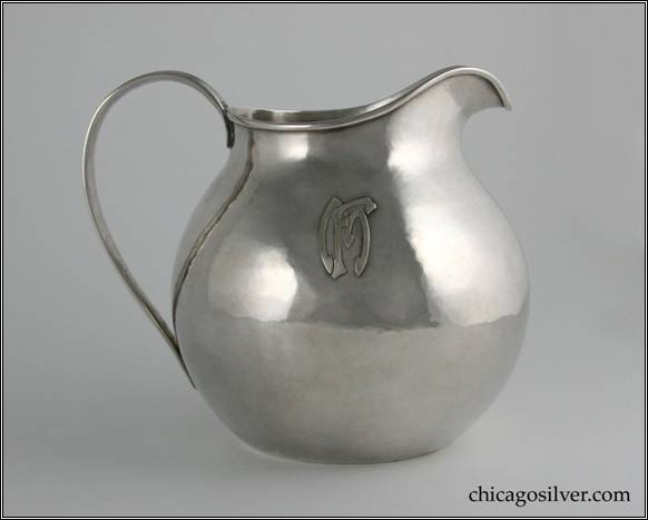 "Kalo pitcher, water, round, flat bottom squat form with looping strap handle.  Hammered surface.  Applied FM mono on side.  6"" H and 6-3/4"" W.  STERLING / HAND WROUGHT / AT / THE KALO SHOPS / CHICAGO / AND / NEW YORK / 9309"