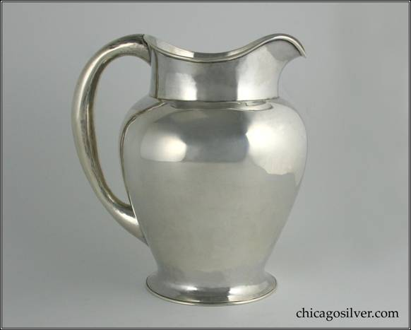 "Kalo pitcher, water, on flared round foot with vase-shaped body.  Necked in top with gently curving spout and looping hollow handle.  7-3/4"" W and 8-1/2"" H.  STERLING / HAND WROUGHT / AT / THE KALO SHOPS / CHICAGO / AND / NEW YORK / 651 / E"