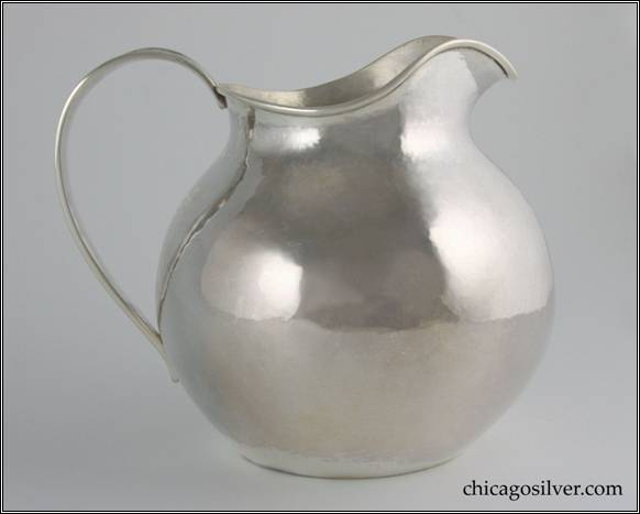"Kalo pitcher, small, squat rounded form on flat bottom with low spout and looping strap handle.  Engraved ""1892 June 1 = 1917"" on side above base.  Technically the mark is post-1917 (since it lacks the "" CHICAGO / AND / NEW YORK"" designation), but it is dated 1917.  We've seen several Kalo items with the Chicago/New York mark dated 1918.  It is entirely possible that these items were made earlier and either sold later out of inventory or sold earlier but engraved later.  In any event the mark and engraving on this pitcher suggest that 1917 was a transitional year for the Shop."