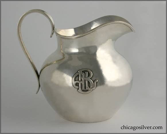 "Kalo pitcher, small milk, low squat form with raised spout and applied wire rim, high looping concave strap handle, with applied ALB monogram, hammered surface.  6-1/8"" H and 7-3/8"" W.  STERLING / HAND WROUGHT / AT / THE KALO SHOP / 9309 / 3 ½ PINTS"