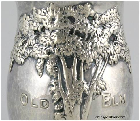 "Kalo vase, commemorative, round, cup-form, with elaborate repousse tree and ""Old Elm"" chased into side -- detail"