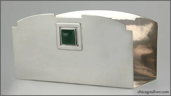 "Kalo letter holder, silver, u-shaped, with flat bottom and straight front and back.  Top of back is curved.  Top of front matches the same curve but with small notches at the top corners and a large flat notch in the center.  Below this is a square applied frame centering a square bezel-set green cabochon stone.  Engraved on the underside is ""October 12, 1910""  An early piece.  7-1/16"" W and 3-5/8"" H and 3-1/8"" D.  HAND BEATEN / AT / KALO SHOPS / PARK RIDGE / ILLS. / 2722"