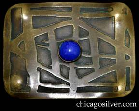 Pin, brass, large, rectangular, with acid-etched geometric design centering bezel-set blue stone.  Four repousse bulges at the corners.  Nice patina.